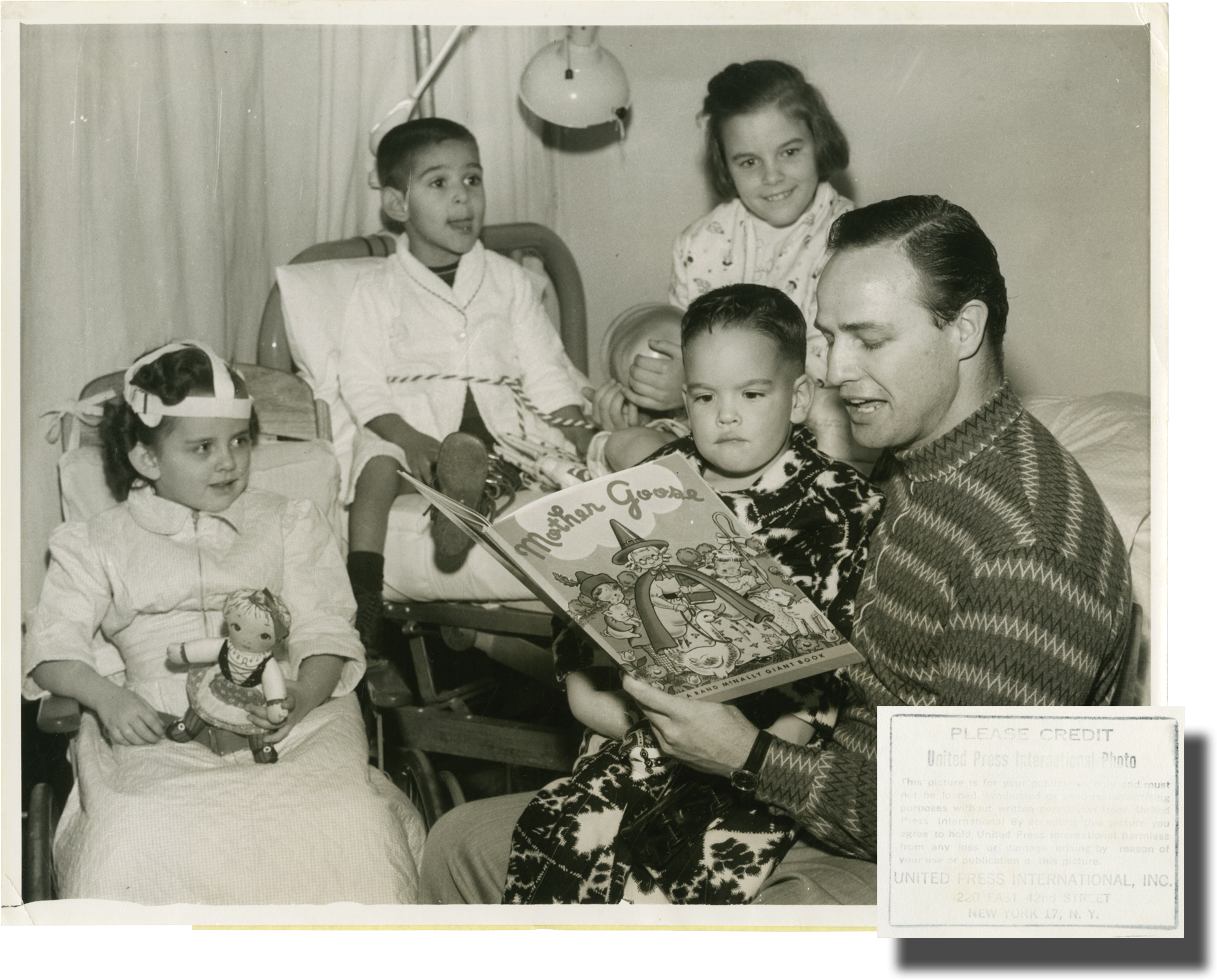 Original photograph of Marlon Brando reading to children ...