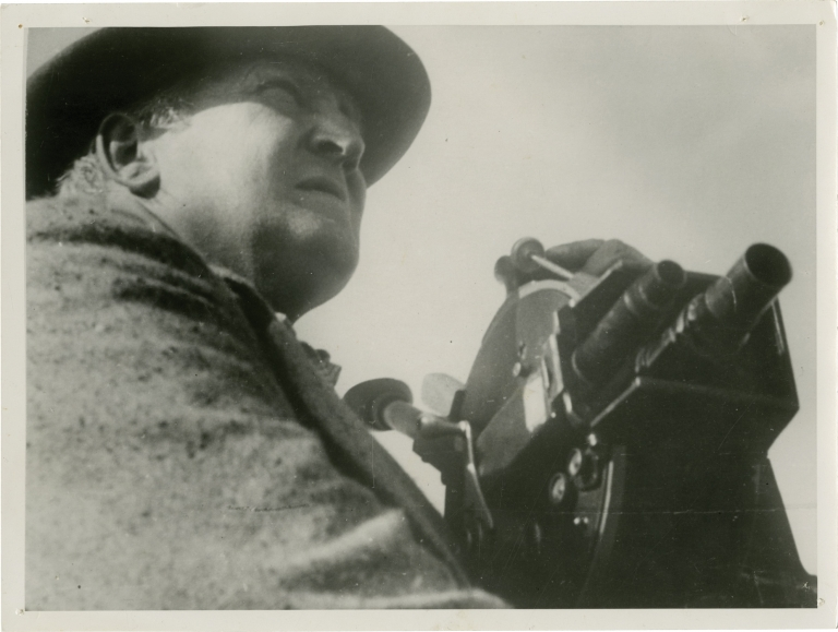 Original double weight photograph of Robert J. Flaherty with his camera. Robert J. Flaherty, subject.