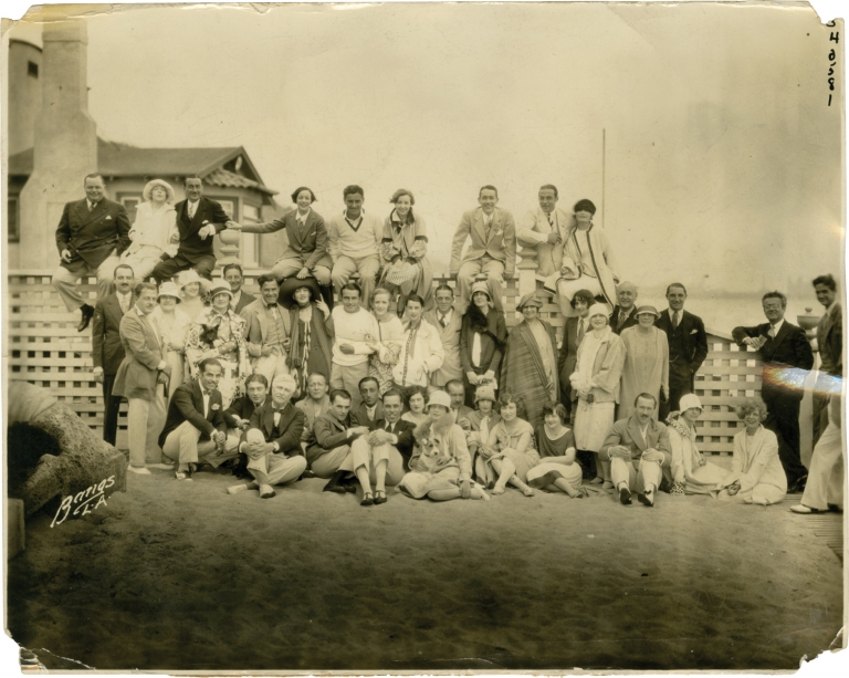 Hollywood stars at a Santa Monica beach party, including Rudolph Valentino, 1926. Hollywood, Pola Negri Rudolph Valentino, others, Ronald Colman, Louella Parsons, Norma Talmadge, Fatty Arbuckle, subjects.