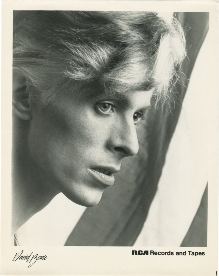 Two original photographs of David Bowie promoting his appearance in the 1976 film The Man Who Fell to Earth. David Bowie, Nicolas Roeg, Walter Tevis, Paul Mayersberg, Candy Clark Rip Torn, Buck Henry, starring, director, novel, screenwriter.