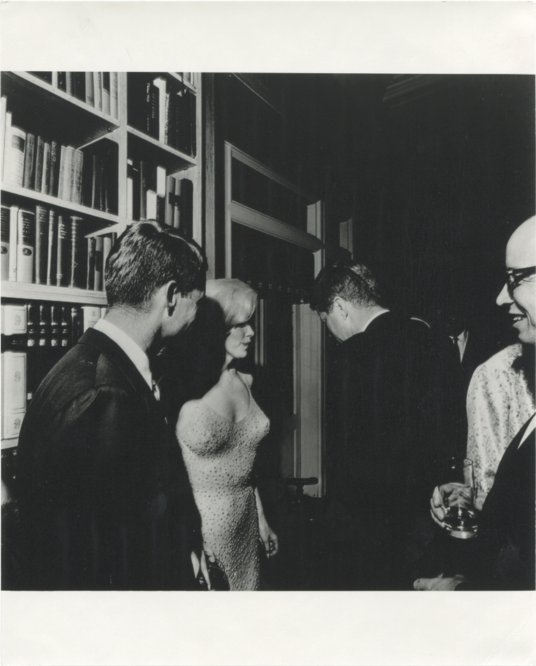Photograph of US President John F. Kennedy, Marilyn Monroe, and Robert Kennedy on the occasion of President Kennedy's 45th birthday celebration. President John F. Kennedy, Robert Kennedy, Marilyn Monroe, Cecil Stoughton, subjects, photographer.
