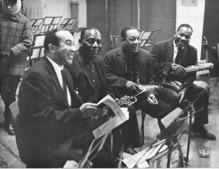 Original photograph of Duke Ellington's Orchestra at L'Olympia Bruno Coquatrix, 1963. Harry Carney, Lawrence Brown Johnny Hodges, Cootie Williams, Alain Dessalles, subjects, photographer.