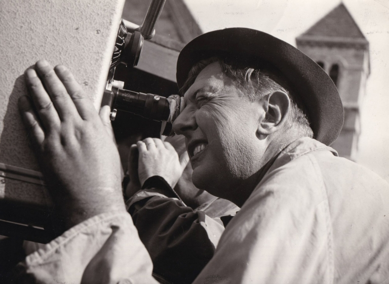 """Original photograph of Jacques Tati, circa 1958, to announce commencement of production for """"Playtime"""" Jacques Tati, subject."""