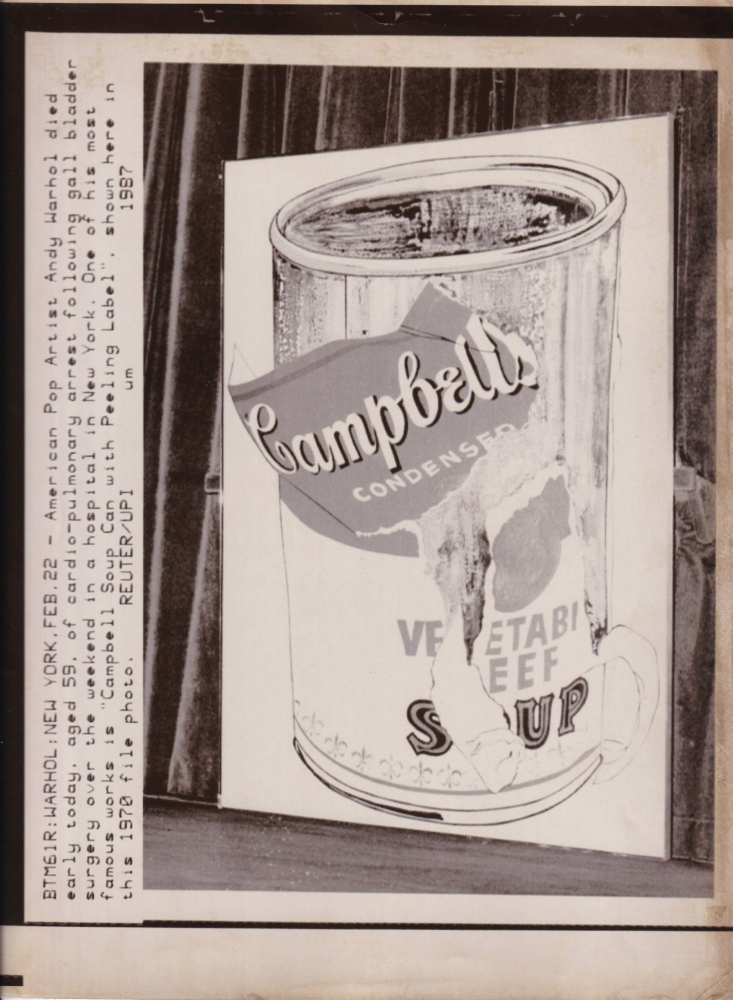 """Original Reuters / UPI wire photograph print announcing Andy Warhol's death, """"Campbell Soup Can with Peeling Label"""" (file photograph), February 22, 1987. Andy Warhol, subject."""