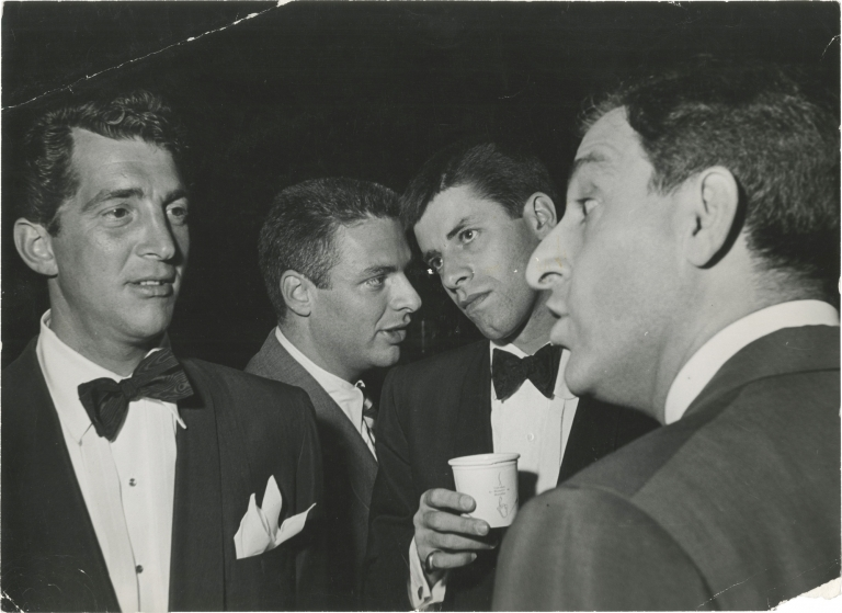 Original photograph of Dean Martin, Jerry Lewis, and Danny Thomas at the LA Examiner's Christmas Benefit, 1952. Dean, Danny Thomas Martin Jerry Lewis, Phil Stern, subjects, photographer.