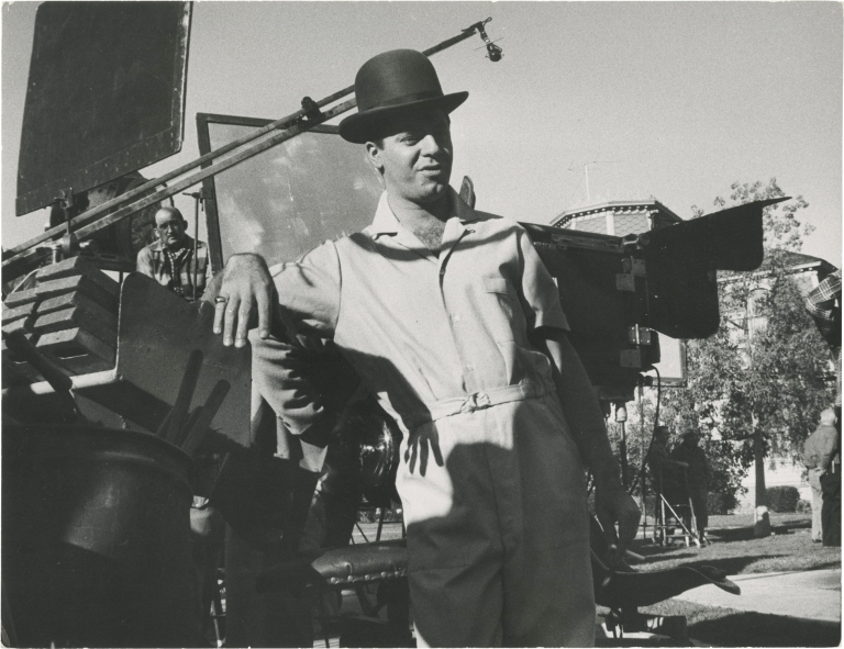 Original oversize photograph of Jerry Lewis in a bowler hat and jumpsuit, circa 1960s. Jerry Lewis, Ted Allan, subject, photographer.