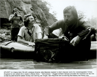 "John Boorman, Vilmos Zsigmond, and Jon Voight on the set of ""Deliverance"" John Boorman, director, James Dickey, novel, Burt Reynolds Jon Voight, starring, Vilmos Zsigmond, cinematographer, James Coe, still photographer."