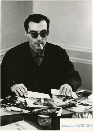 A bout de souffle [Breathless] (Two original photographs of Jean-Luc Godard at work on the 1960...