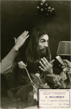 "George Harrison at a press conference for ""All Things Must Pass,"" circa 1970"