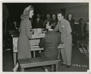 Step Lively (Original photograph of Frank Sinatra, director Tim Whelan, and actress Gloria DeHaven from the set of the 1944 film). Fred Hendrickson, Tim Whelan, Peter Milne Warren Duff, John Murray Allen Boretz, George Miller Frank Sinatra, Gloria DeHaven, photographer, director, screenwriters, play, starring.