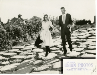 Nicholas Ray and Betty Utey on the stones in Rome (Original press photograph). Nicholas Ray,...