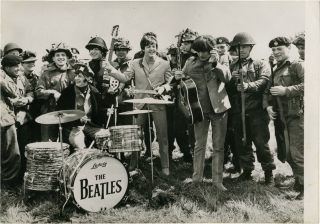 Help (Original photograph from the set of the 1965 film). The Beatles, Richard Lester, director, Robert Cohen, photographer, Charles Wood Marc Behm, screenwriters, Paul McCartney John Lennon, Ringo Starr, George Harrison, starring.