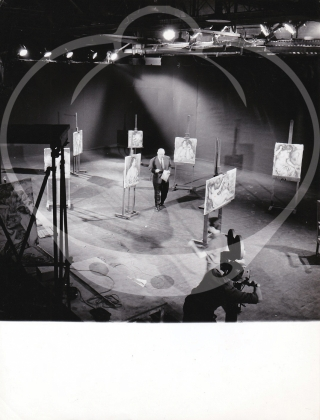 Archive of five original photographs of Jean Renoir on French television, 1958