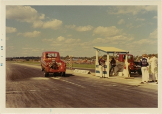 Archive of 18 vernacular photographs of drag races at the National Trail Raceway. Auto Racing,...