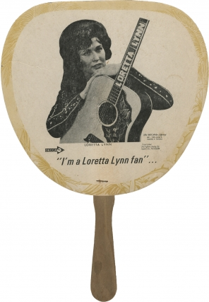 "Original promotional ""I'm a Loretta Lynn fan"" paddle hand fan. Loretta Lynn, subject"