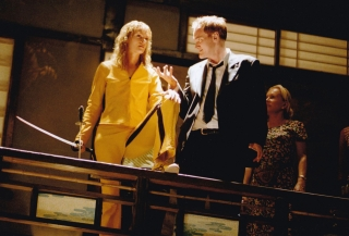 Kill Bill: Volume 1 (Original photograph from of Uma Thurman and Quentin Tarantino on the set of...