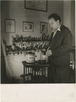 Original photograph of Arthur Honegger filling his pipe, circa 1940s. Arthur Honegger, subject