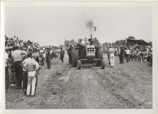 Archive of 12 vernacular photographs of a tractor pull at the Boone County Fair in Indianapolis, circa 1964