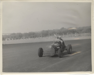 Archive of 14 vernacular photographs of open wheel races at the Iowa State Fair, circa 1950s....