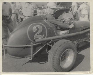 Archive of 14 vernacular photographs of open wheel races at the Iowa State Fair, circa 1950s