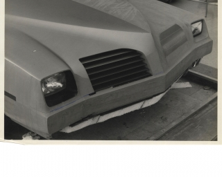 Archive of ten vintage photographs of a full-size clay model Pontiac, circa 1970s. Automobiles,...