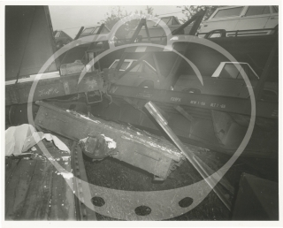 Archive of 32 photographs and a reward poster for a train accident in Raytown, Missouri, 1970