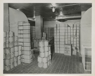 Collection of nine original photographs of industrial dairy freezers, circa 1950s
