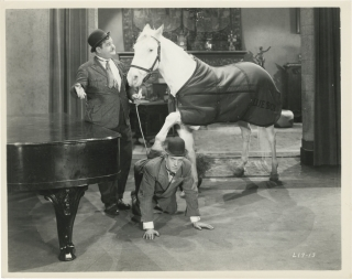Wrong Again (Collection of 7 original photographs from the 1929 film). Stan Laurel, Oliver Hardy,...