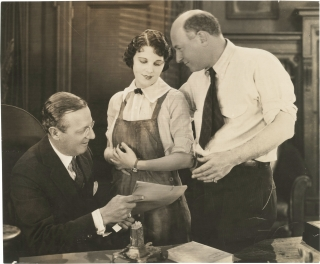 "Original press photograph of Leatrice Joy being presented a ""star contract"" by Cecil B. DeMille..."